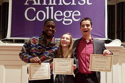 Winners of Truth: Amhert College's Speaking Compeition holding their winners' certificates