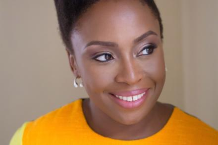 Chimamanda Ngozi Adichie smiles, looking slightly away from camera