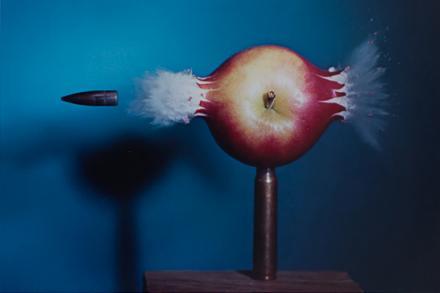 Print by Harold Edgarton of bullet piercing an apple