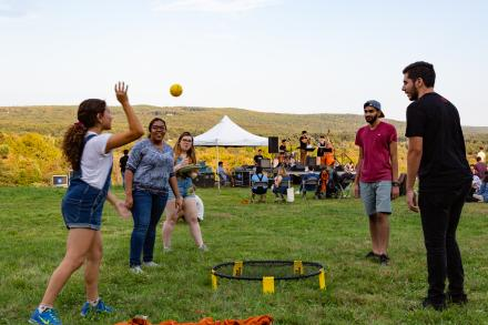 Students play spikeball at Farm Fest