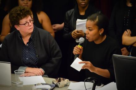 President Martin listens while a student talks at the Amherst Uprising