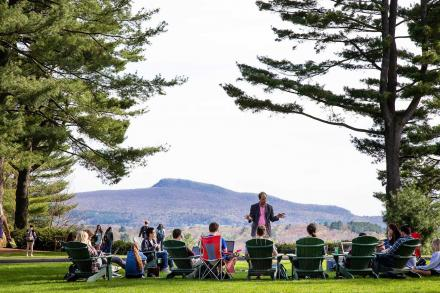 A professor leads a class on the Main Quad at Amherst College