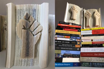 book with a raised solidarity fist sculpted into it