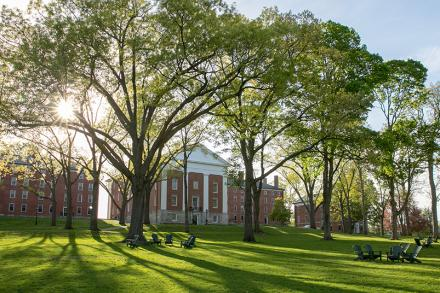 A photo of Johnson Chapel with the sun shining through trees