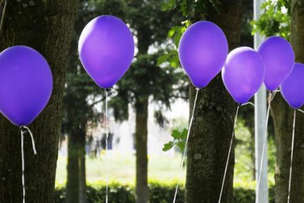 purple balloons at an outdoor celebration