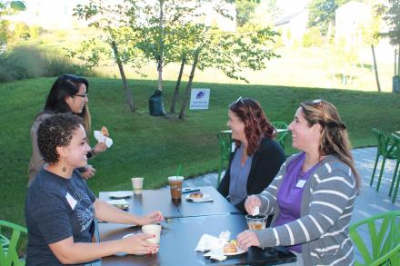 staff members sitting together talking at a Human Resources event