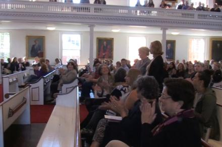 In Johnson Chapel, staff members stand to be recognized and applauded