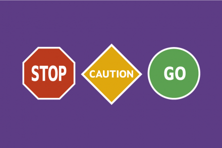 signs saying stop, caution, go