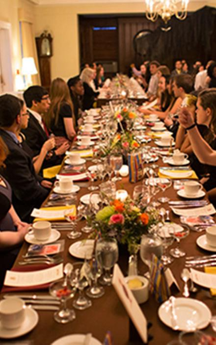 Students seated at a formal dinner
