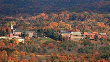 aerial view of the Amherst campus surrounded by trees in autumn