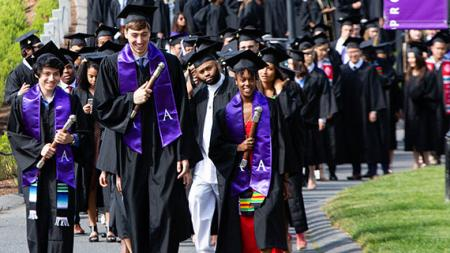 The student marshals leading the way to Commencement