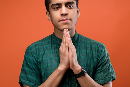 Tomal Hossain holds his hands in a praying position.
