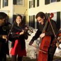 Half of Mendelssohn Octet, performing outdoors on campus