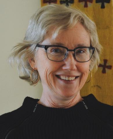 woman wearing glasses smiling at camera