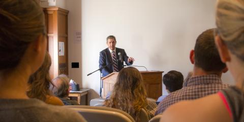 Limbrinidis speaking to Amherst students