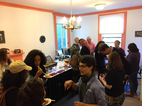 Faculty and students mingling at Fall Reception