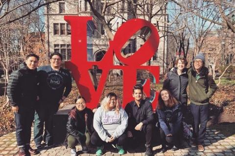 Picture of students surrounding LOVE sculpture