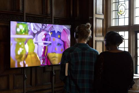 Mead visitors watching a video inside the Rotherwas Room