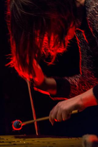 Portrait of percussionist Sarah Hennies playing xylophone