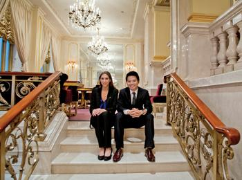 Lacie Goldberg '13 and Henry Bao-Viet Nguyen '13 seated on hotel staircase