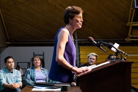 Katie Fretwell speaking at a podium at Amherst College Orientation 2017