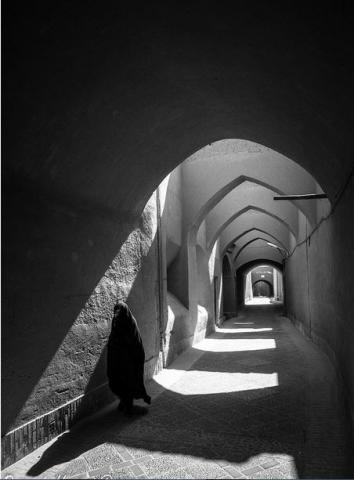 Shadowed hallway with Islamic woman