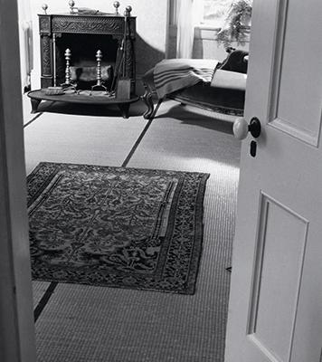 1960s view of the poet's bedroom shows her original Franklin stove and, on the lounge, her blanket.