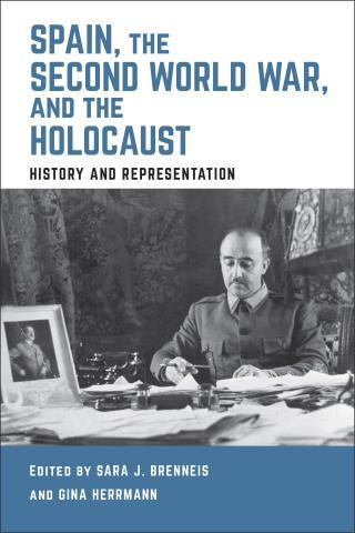 Francisco Franco at his desk with a framed photo of Adolf Hitler.