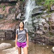 Diane_Lee standing in front of a waterfall