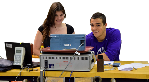 Two student working together in front of a computer.