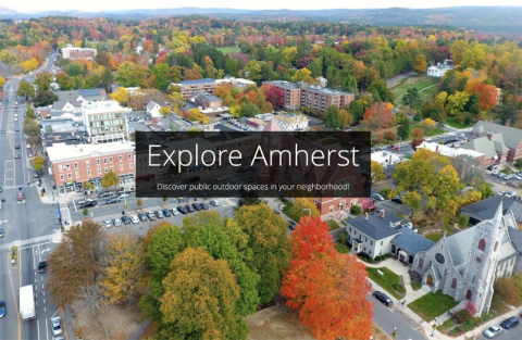 Aerial view of the town of Amherst with the title Explore Amherst, Discover public outdoor spaces in your neighborhood