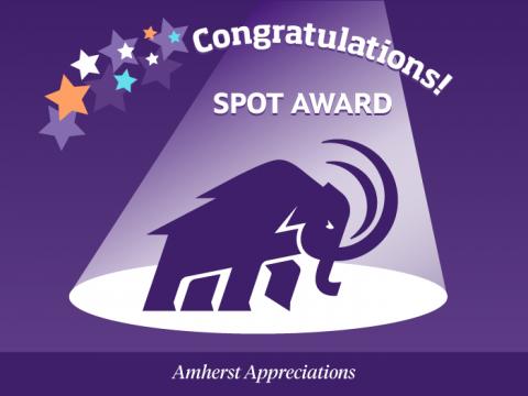 Congratulations! Spot Award. Amherst Appreciations. Mammoth stands in a spotlight.