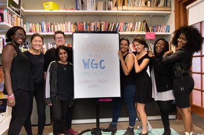 Staff and students pose smiling in the Women's and Gender Center