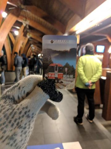 Gloved hand holding train ticket