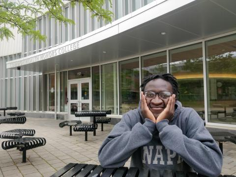 Brandon sitting at Umass' honors college