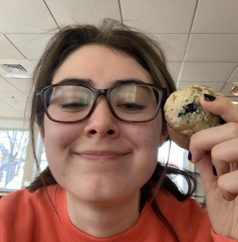 me eating a muffin at val