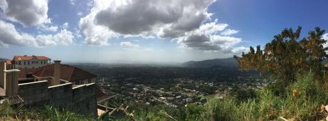 a beautiful panorama from the top of a large hill; overlooking Jamaica