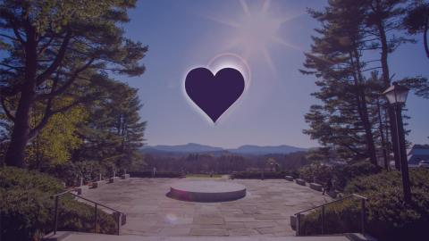 A heart pictured with the sun over memorial hill