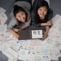 Ha Ram Hwang and Ju Hyun Lee surrounded by contributions to The Multilingual Game
