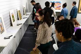 Students studying paintings in a classroom setting