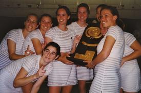 Women's tennis team holding their NCAA trophy 1999
