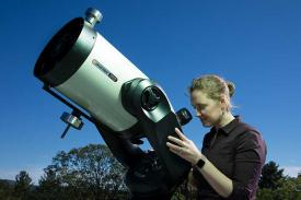 Kate Follette with telescope at the Observatory
