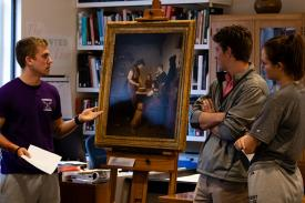 Students examining artwork in the Mead Art Musuem
