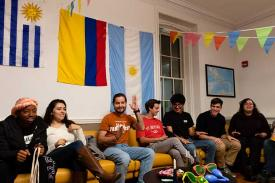 Student gather in a lounge decorated with international flags