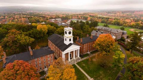 Aerial view of the Amherst College campus in fall