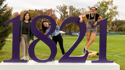 Students posing with the 1821 sign at Amherst College
