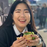 person holding sandwich