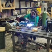 Student worker in production shop