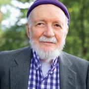 Lou Dolbeare '40 in purple checked-shirt and purple knit cap