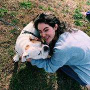 Victoria Foley '23 petting an alumni's dog at the 2019 Homecoming football game!
